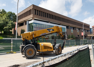 Construction equipment drives down Waverly Avenue, in front of the Newhouse 2 building, as work continues on a sewer line upgrade project. Work is expected to be completed in August. Photo taken July 18, 2017